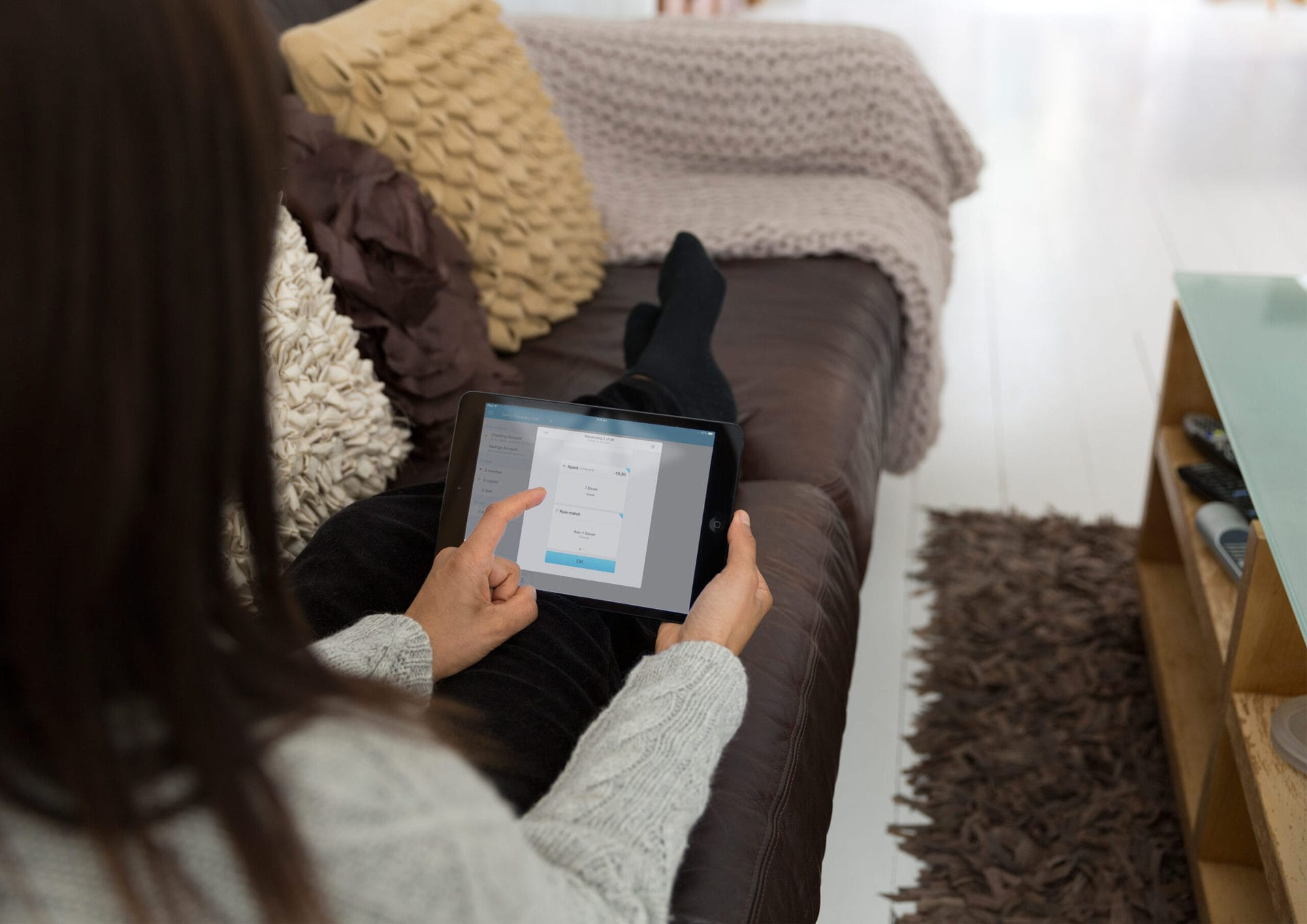 Woman using a tablet to check her business accounts