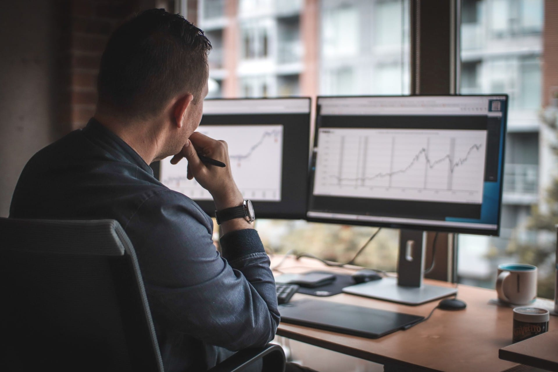A man reviewing financial forecasts at his desk for financial planning