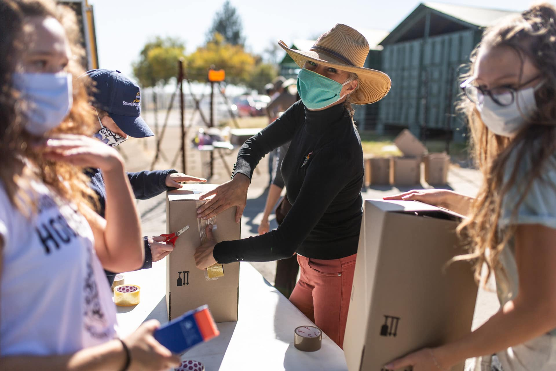 Volunteers working outdoors wearing face masks for not-for-profit